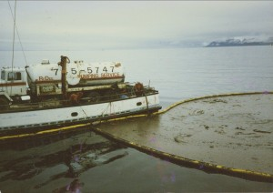 Fishing vessel Defiance with sewage vacuum truck sucking oil